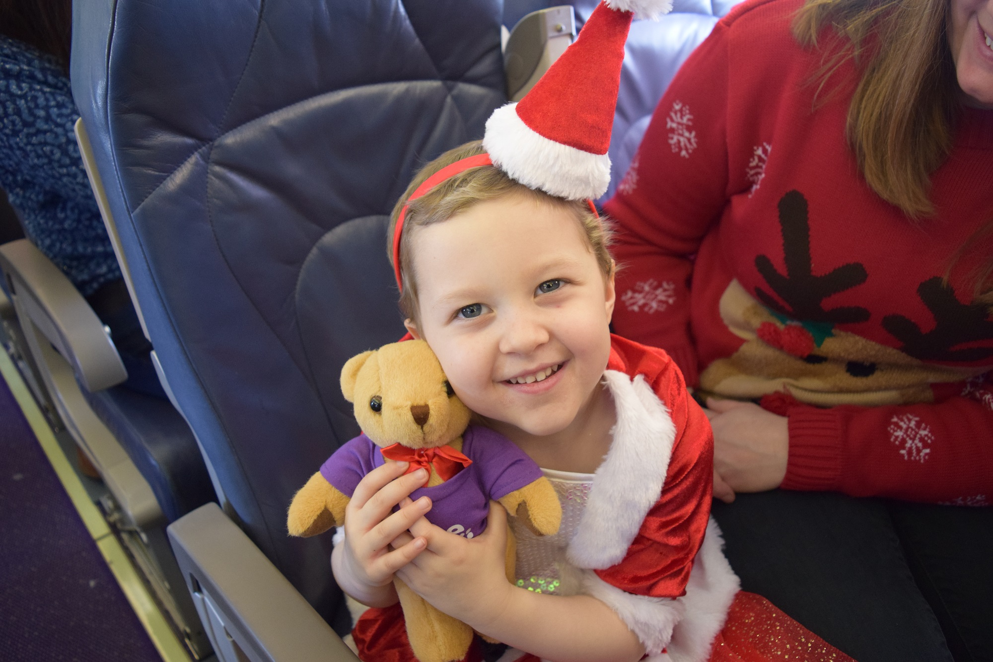 Patient from the Southampton Hospital with her teddy bear from Flybe's Santa