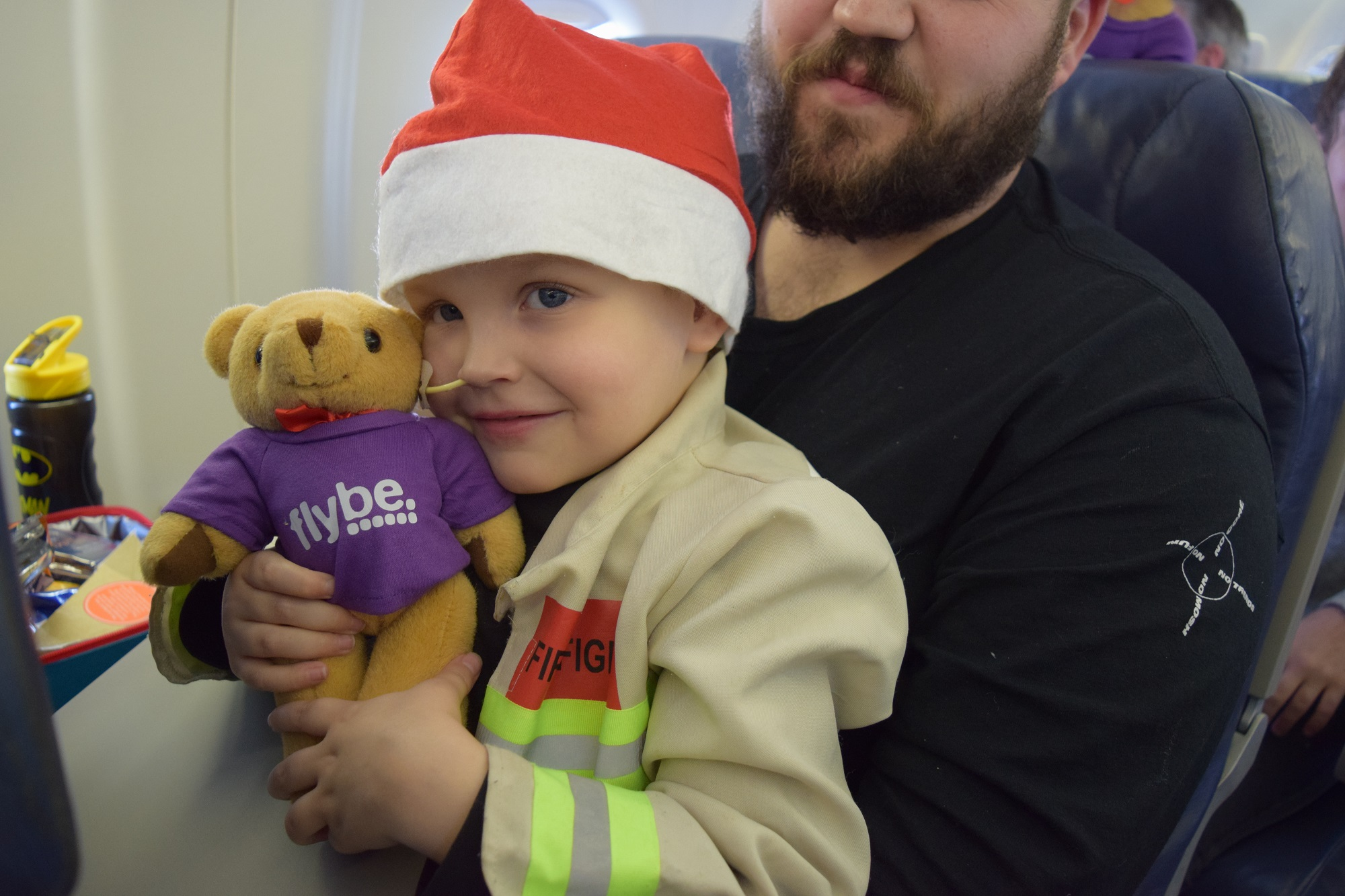 Child with teddy from Santa on the Flybe flight from Southampton Airport