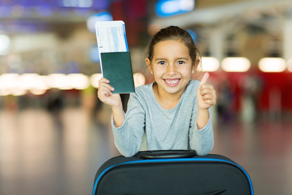 Girl gives thumbs up for Southampton Airport Children's facilities!